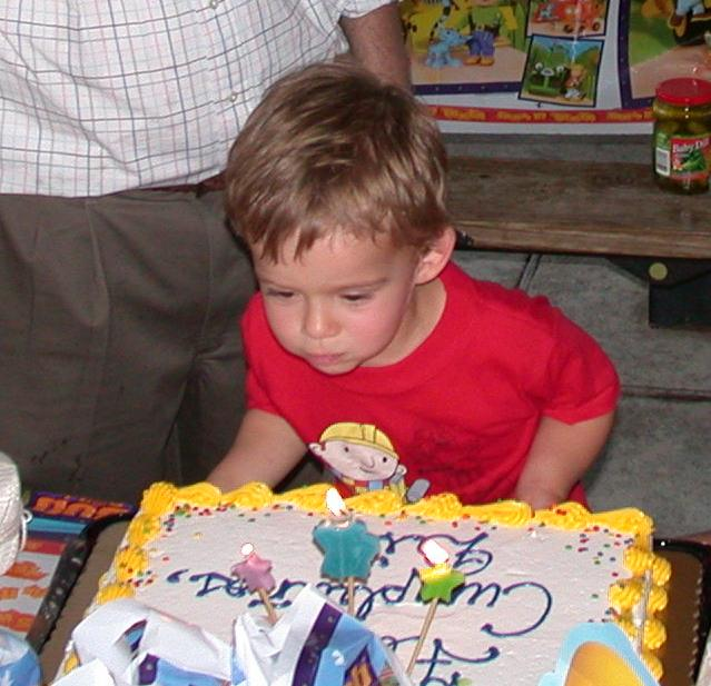William John Scott blowing out three candles!
