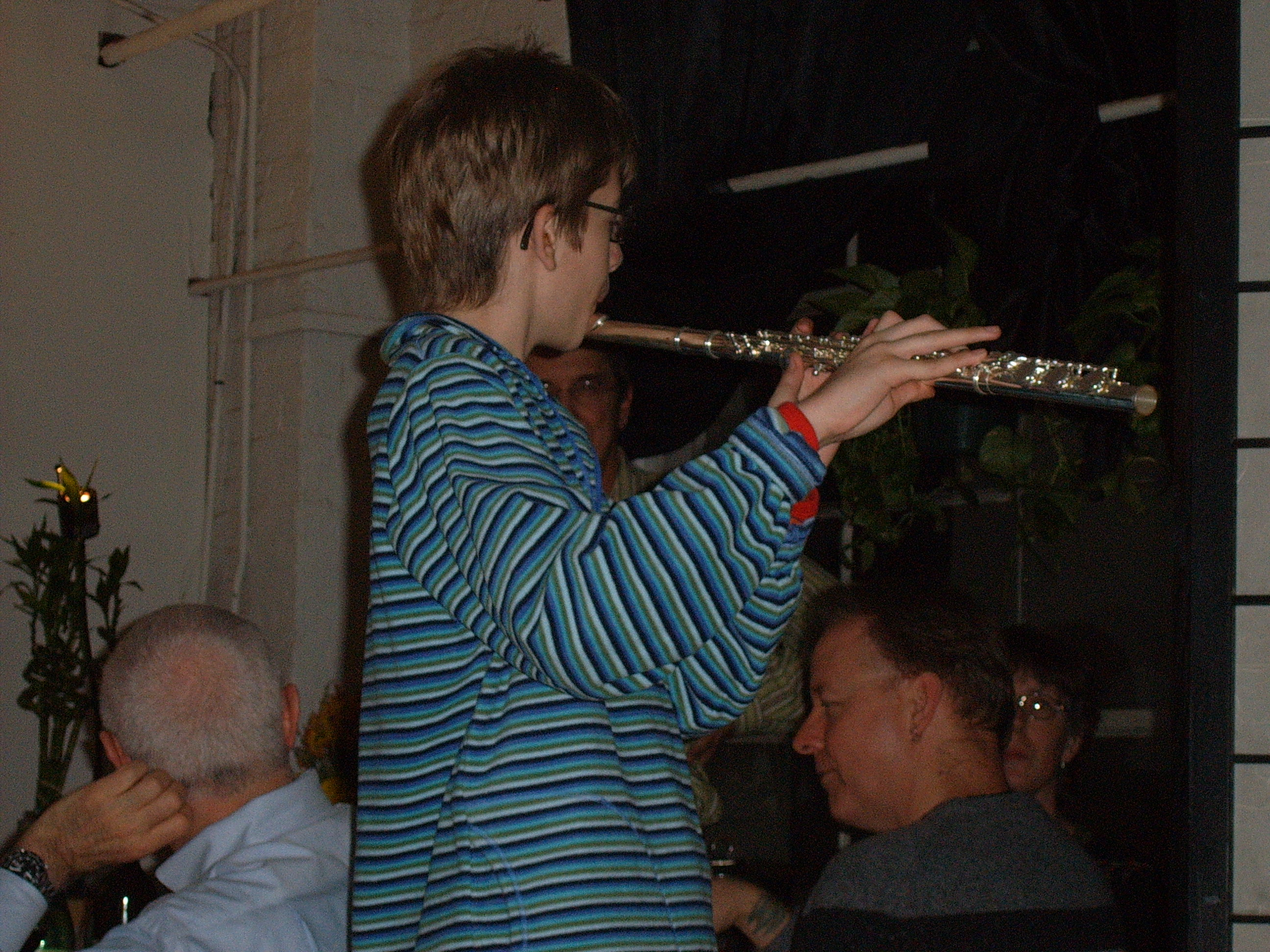 Cousin Ian Edgar plays the flute at Thanksgiving 2006 in NYC--his father Steve Edgar looks on