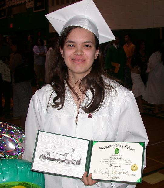 Heather Giselle Scott with her high school diploma